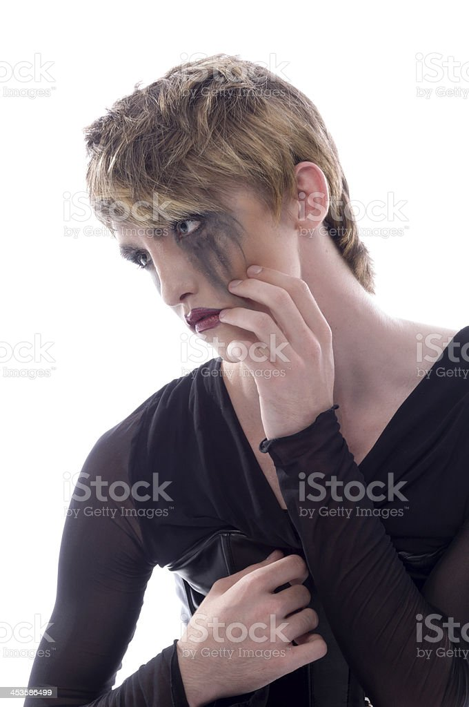 Young man in smeared makeup from crying. stock photo