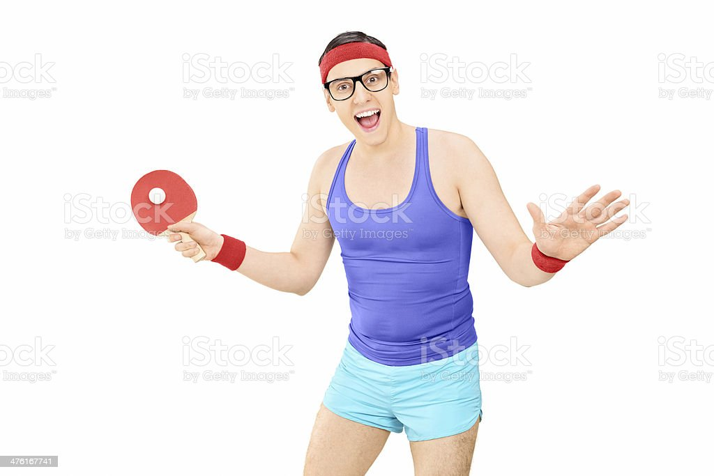 Young man in sportswear playing ping-pong stock photo