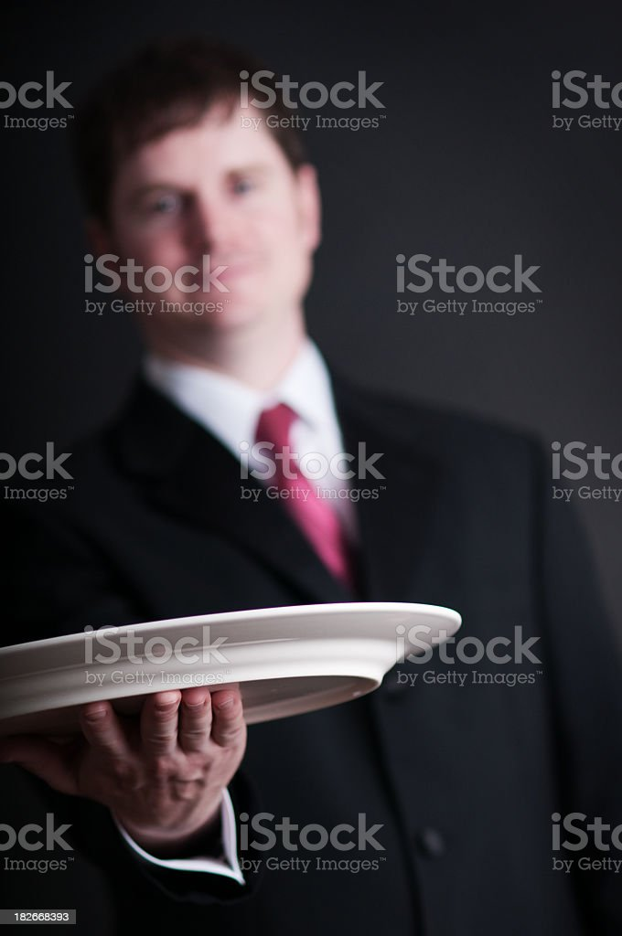 Young Man in Suit and Tie with Serving Platter royalty-free stock photo