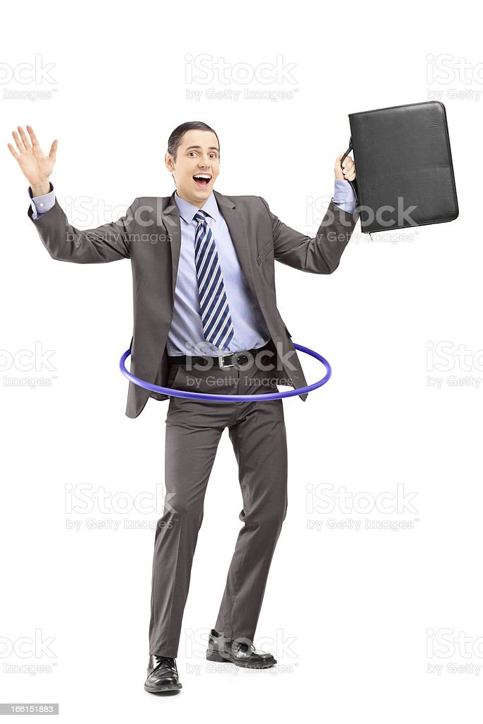 Young man in suit dancing with a hula hoop royalty-free stock photo