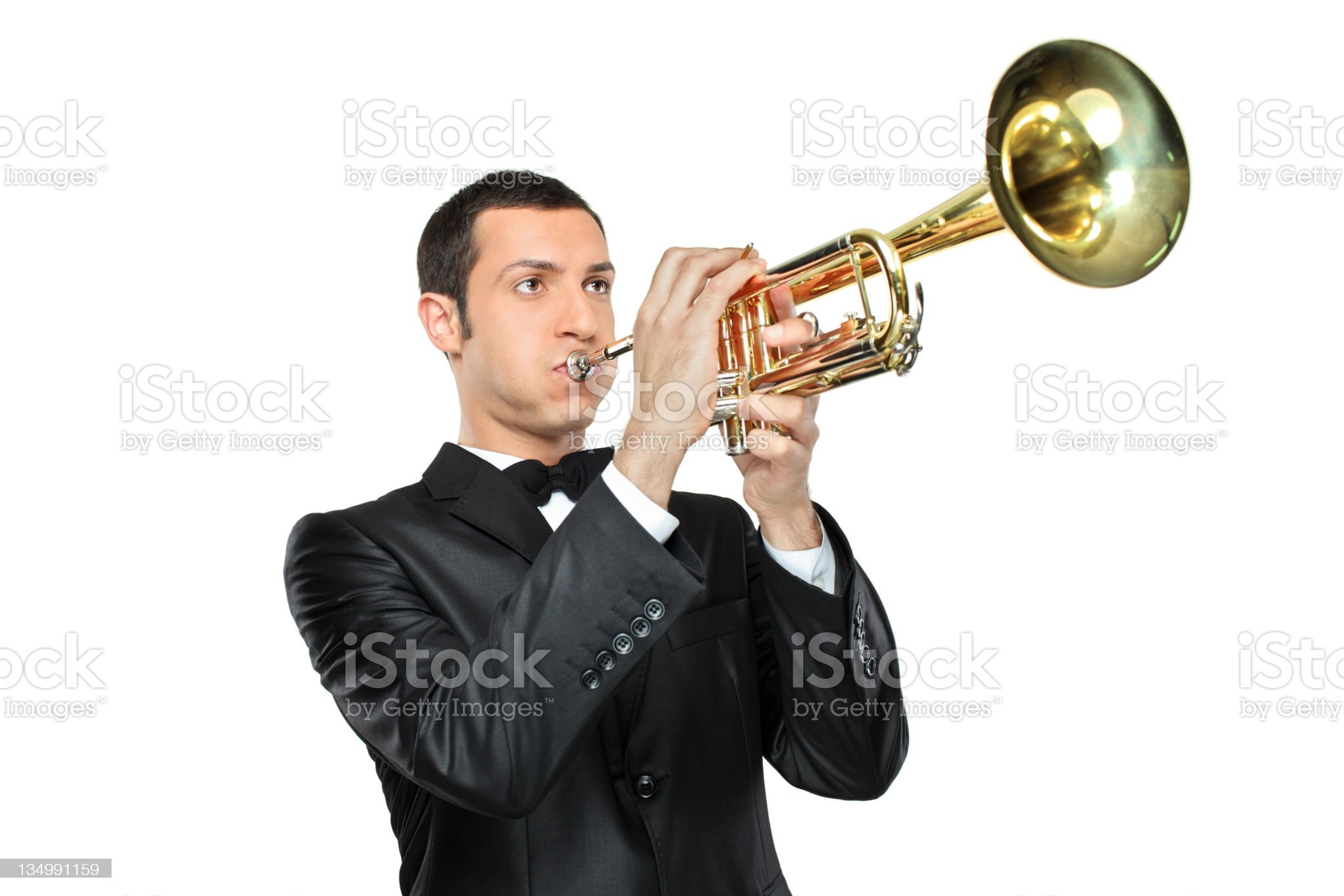 Young man in suit playing a trumpet royalty-free stock photo