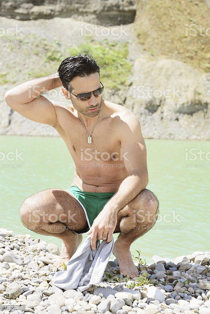 Young man in summer at lake royalty-free stock photo