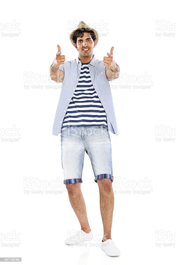 Young man in summer outfit pointing at you royalty-free stock photo