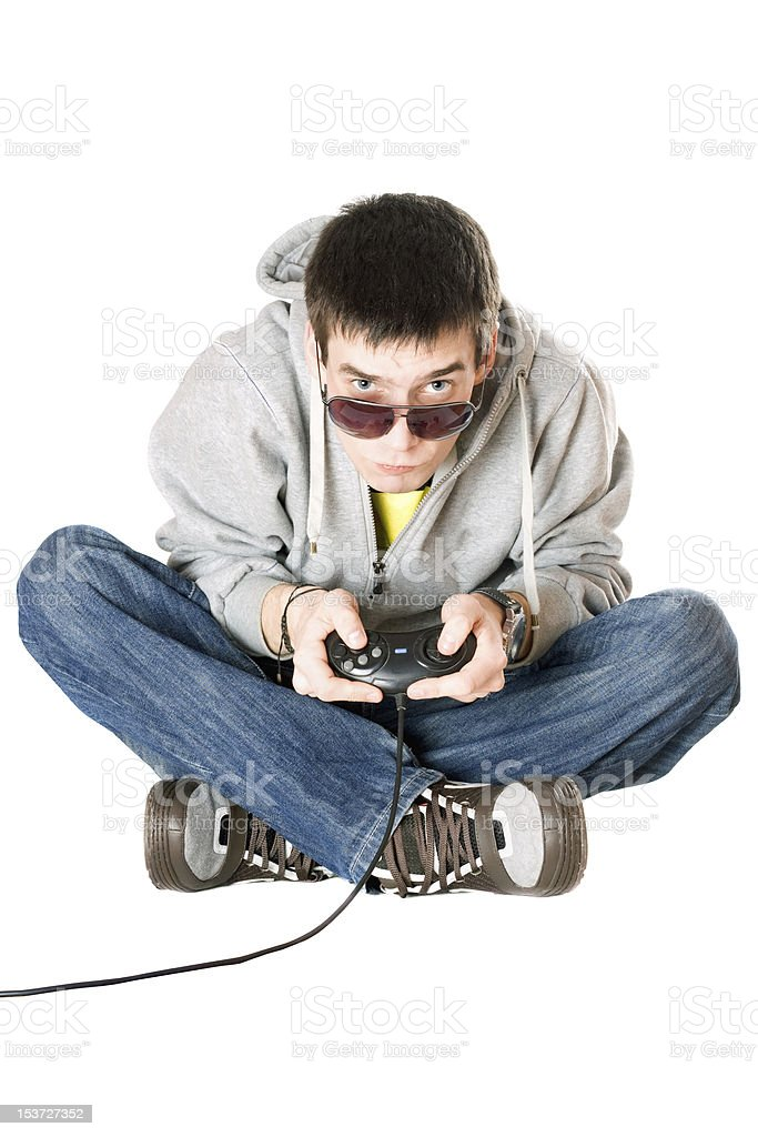 Young man in sunglasses with a joystick royalty-free stock photo