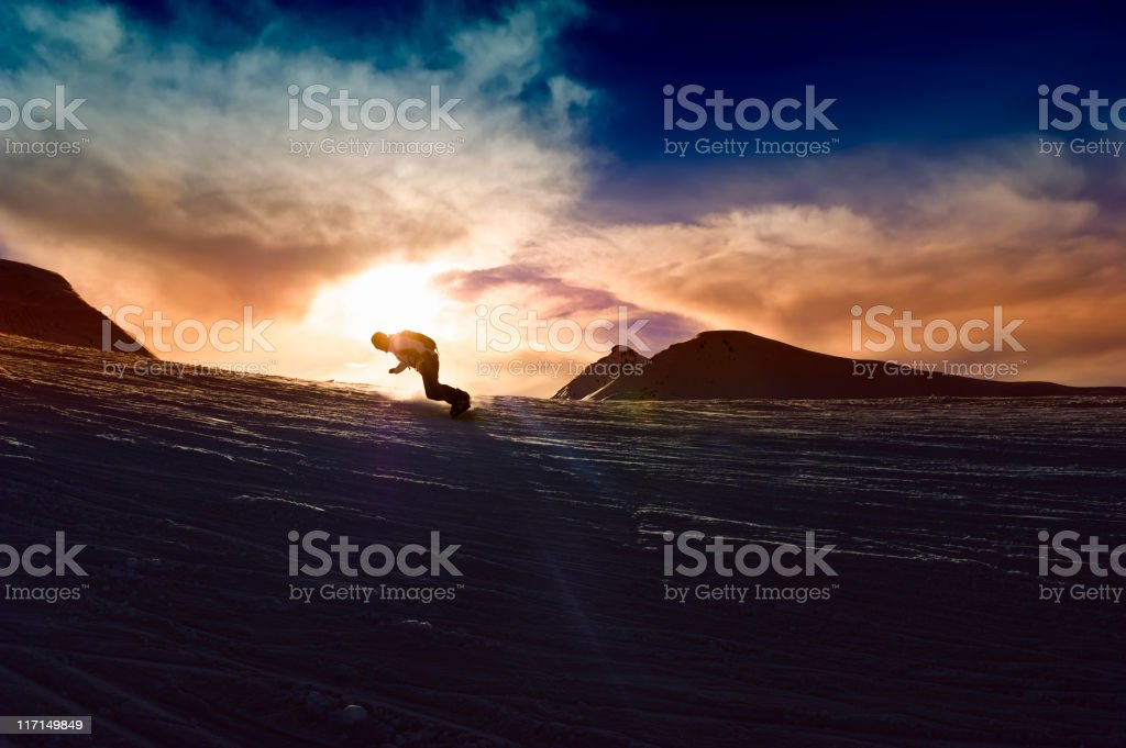Young man in sunset Powder snow stock photo