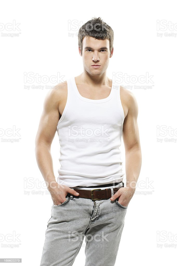 Young man in tank top with hands in pockets stock photo