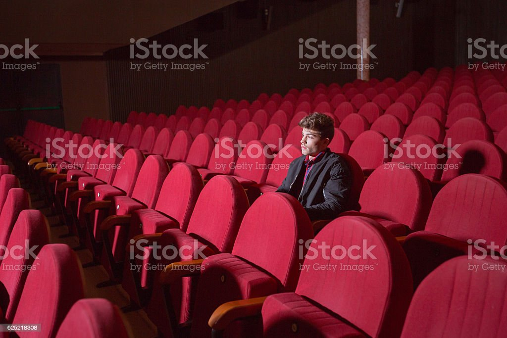 Young man in the cinema stock photo