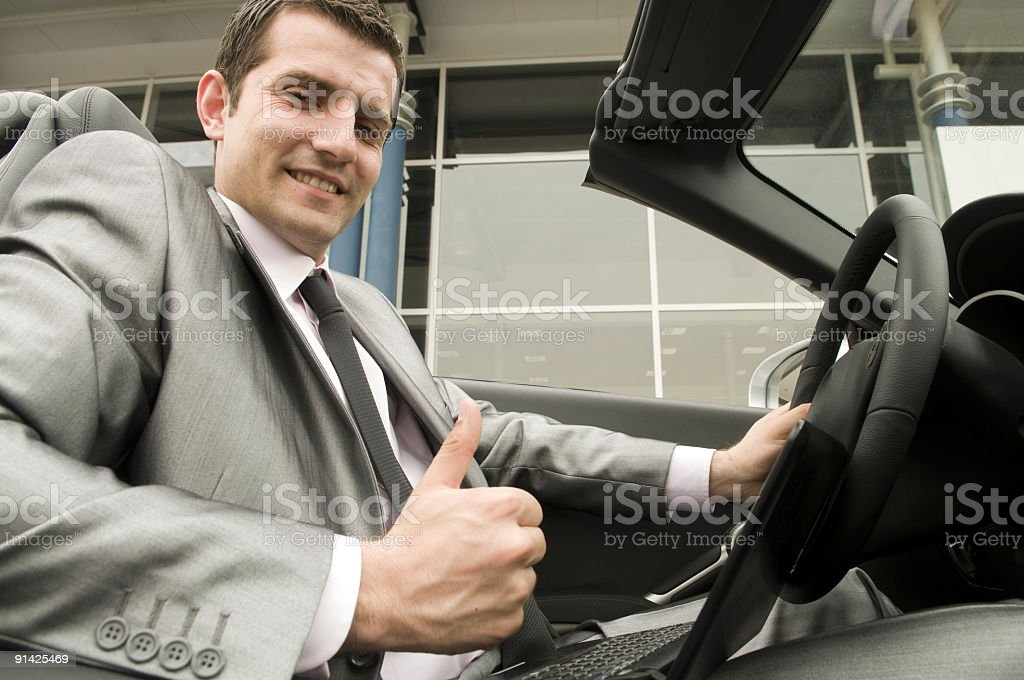 Young man in the convertible royalty-free stock photo