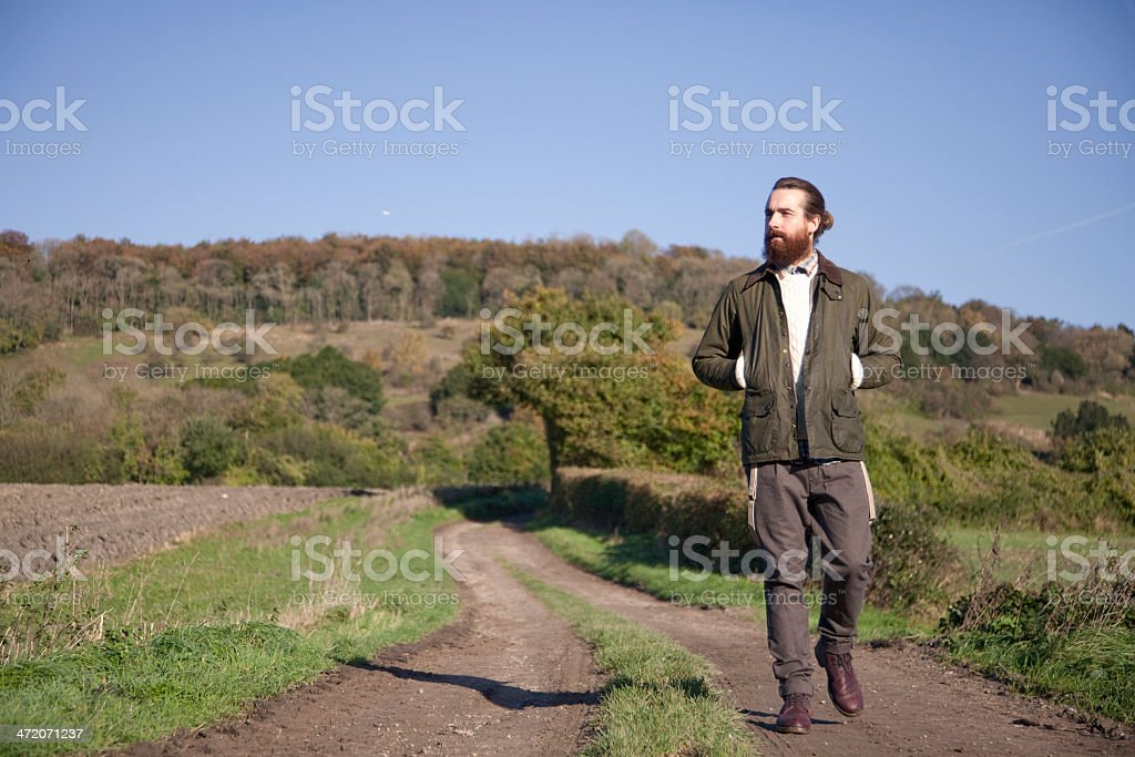 Young man in the countryside stock photo
