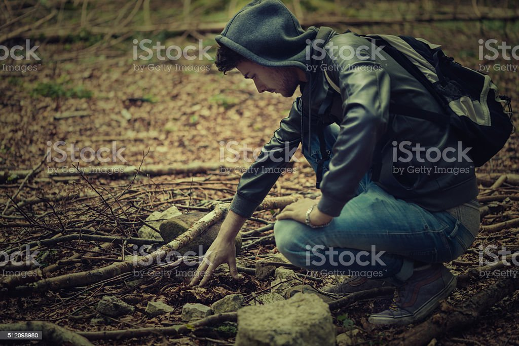 Young man in the forest stock photo