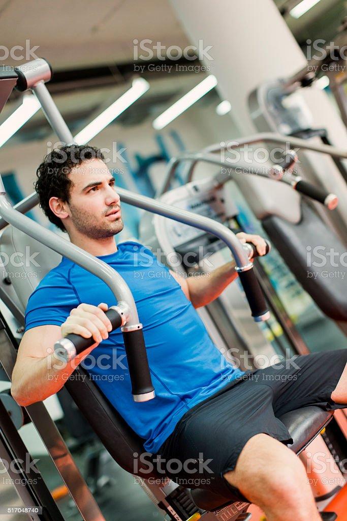 Young man in the gym stock photo