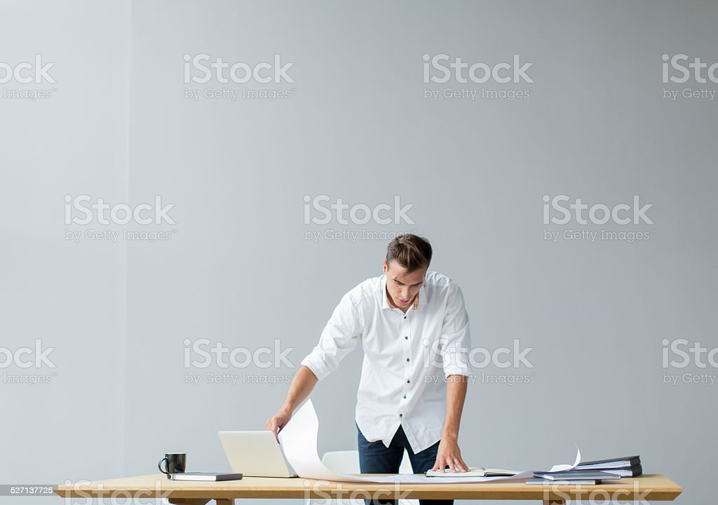 Young man in the office stock photo