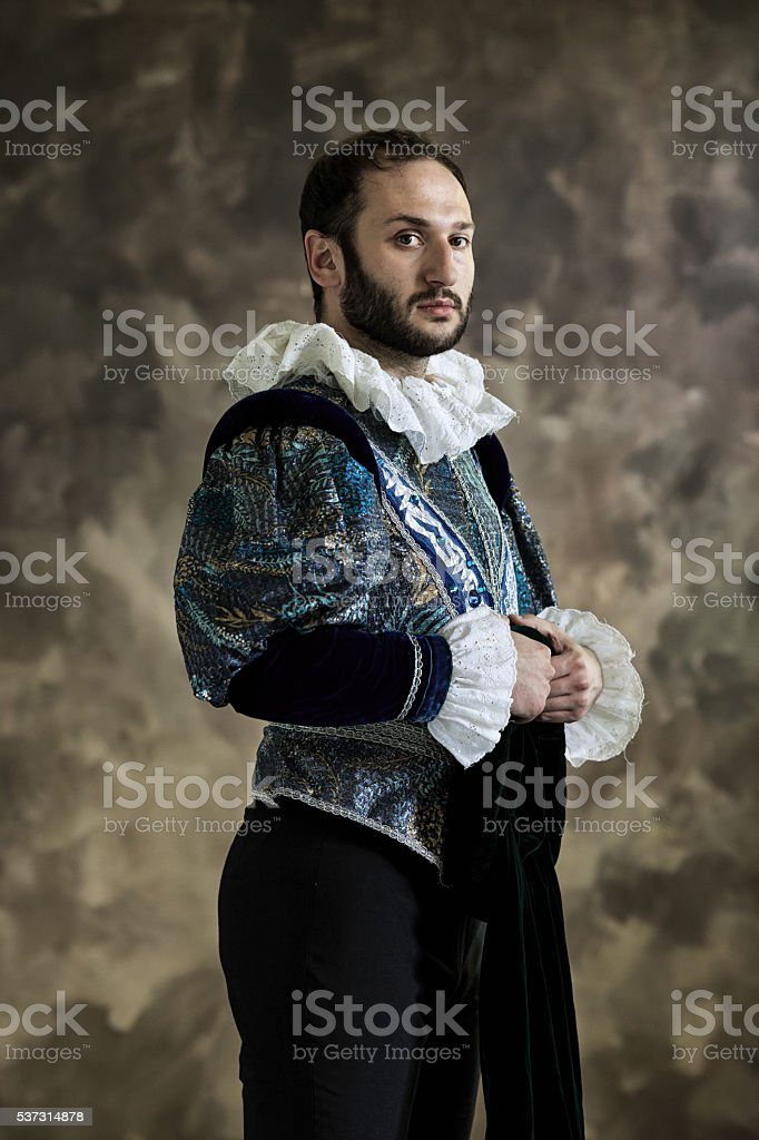Young man in theatrical costume stock photo