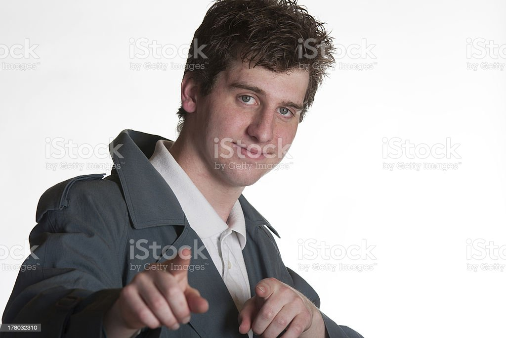 young man in trench coat stock photo
