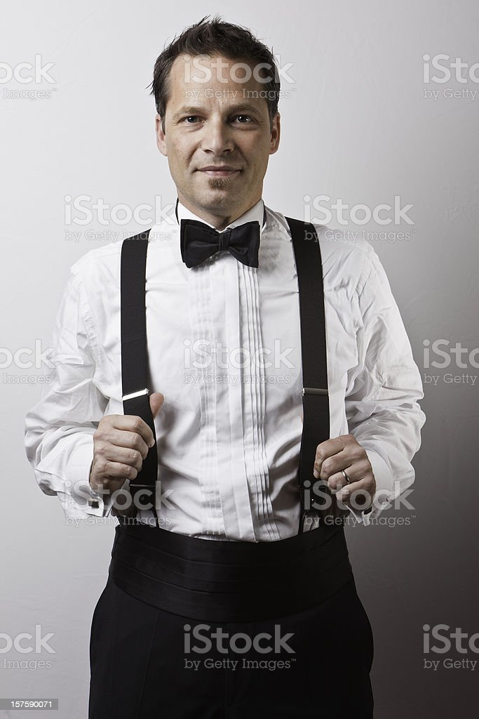 Young man in tuxedo with black tie stock photo