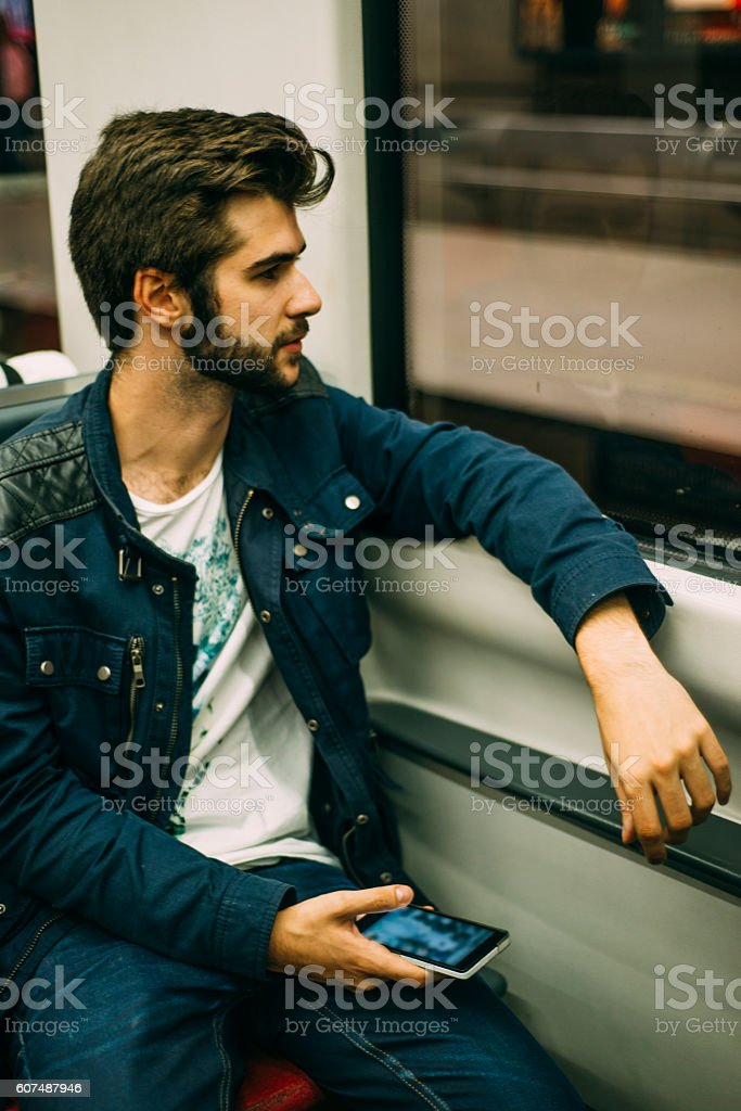 Young man in underground train stock photo