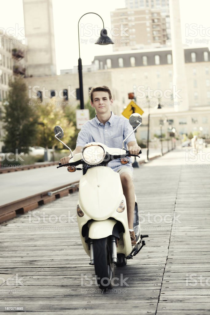 Young Man in Urban City with Scooter Moped royalty-free stock photo