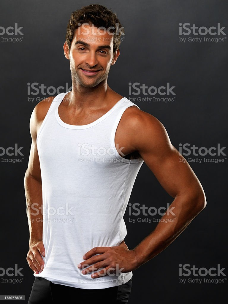 Young man in vest smiling and looking at you royalty-free stock photo