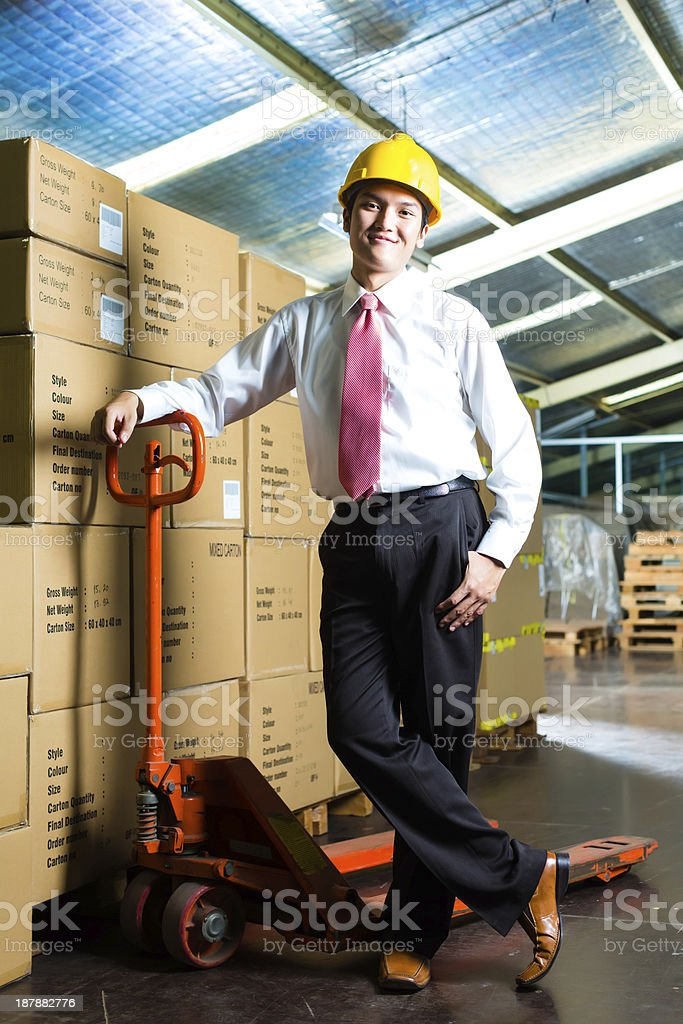 Young Man in warehouse he is a manager royalty-free stock photo