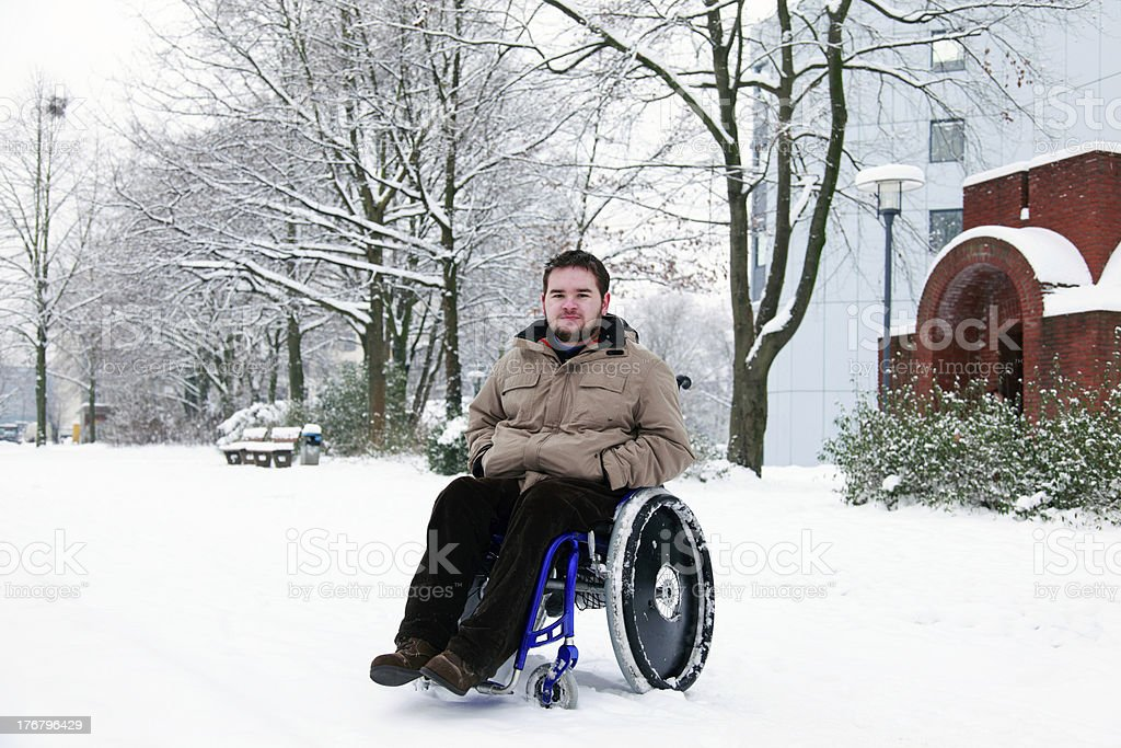 young man in wheelchair royalty-free stock photo