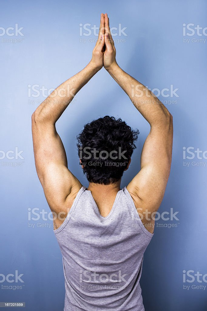 Young man in yoga pose royalty-free stock photo