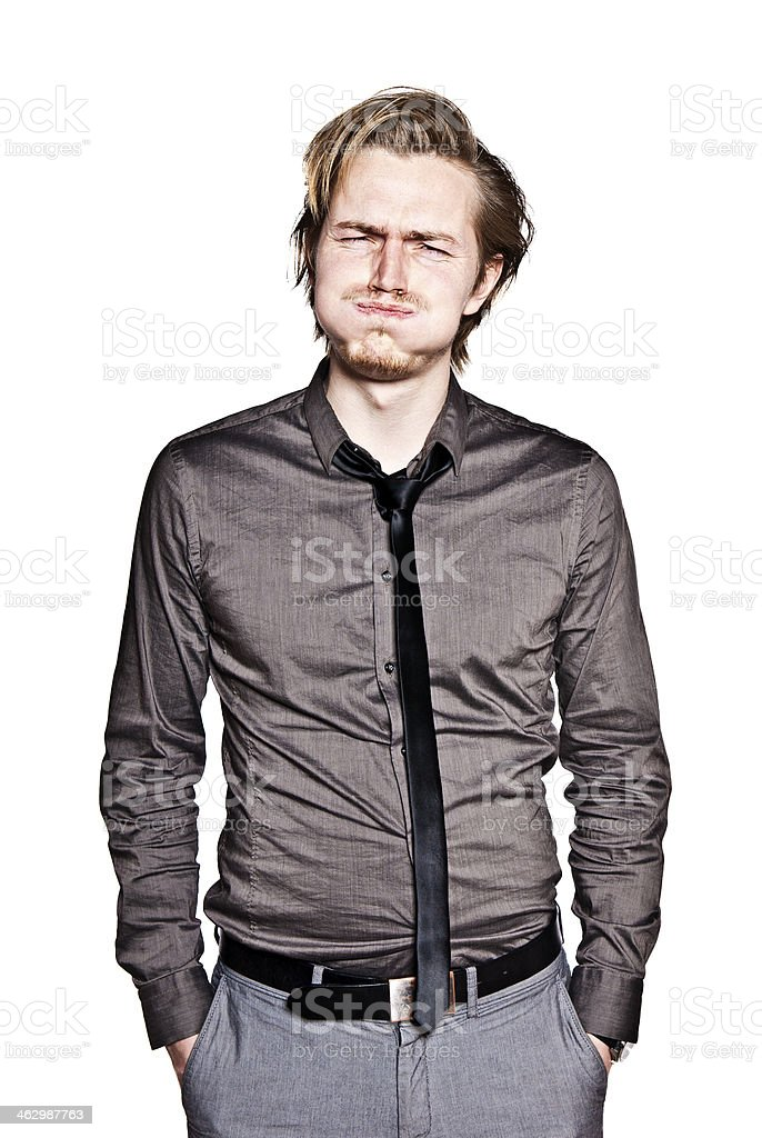Young man is blowing cheeks stock photo
