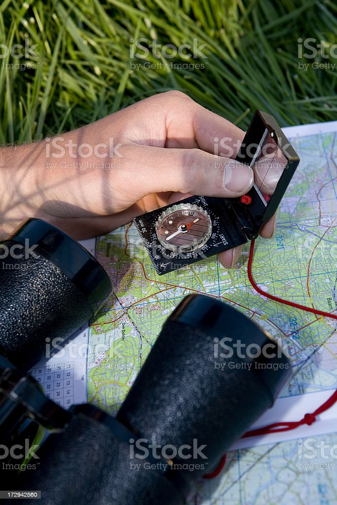 Young man is discovering the map compass binocular royalty-free stock photo