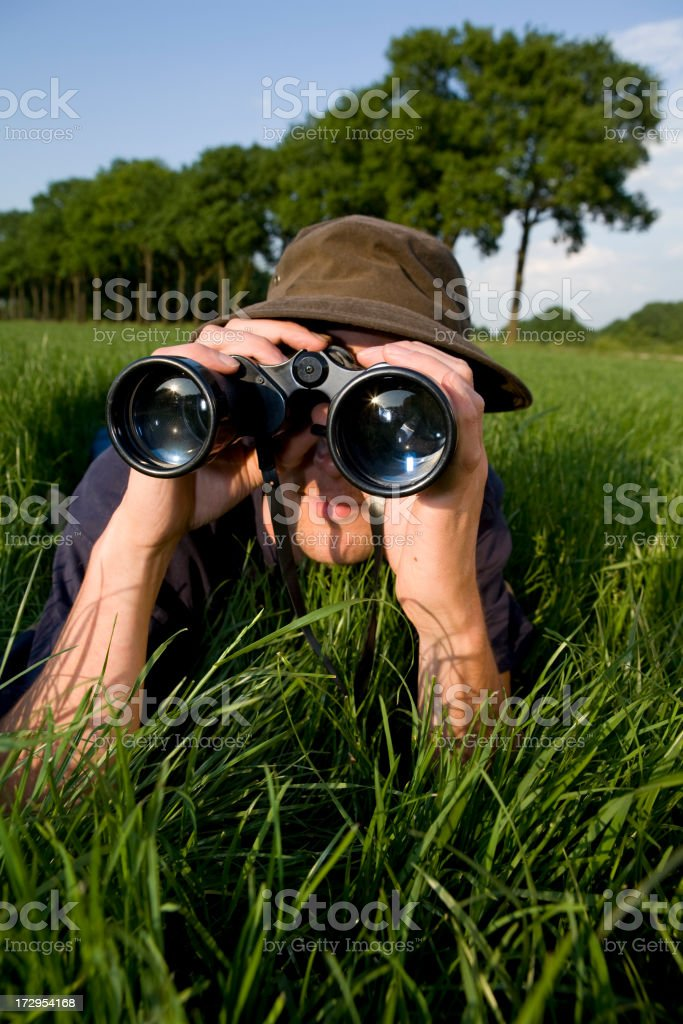 Young man is discovering the surrouding royalty-free stock photo