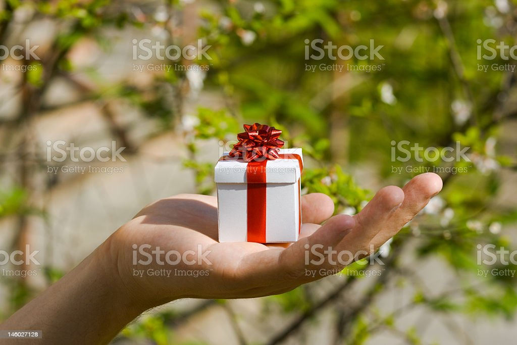 Young man is giving a gift royalty-free stock photo