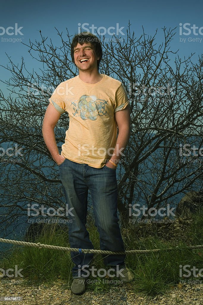 Young man is laughing on sea stock photo