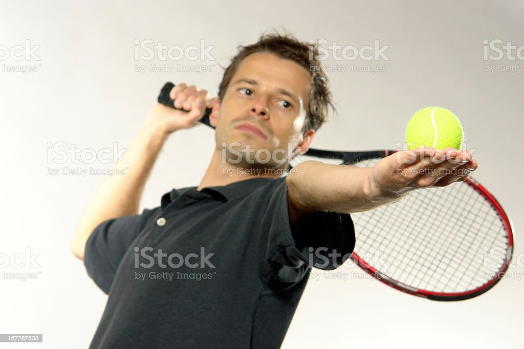 Young man is playing tennis, he is going to service royalty-free stock photo