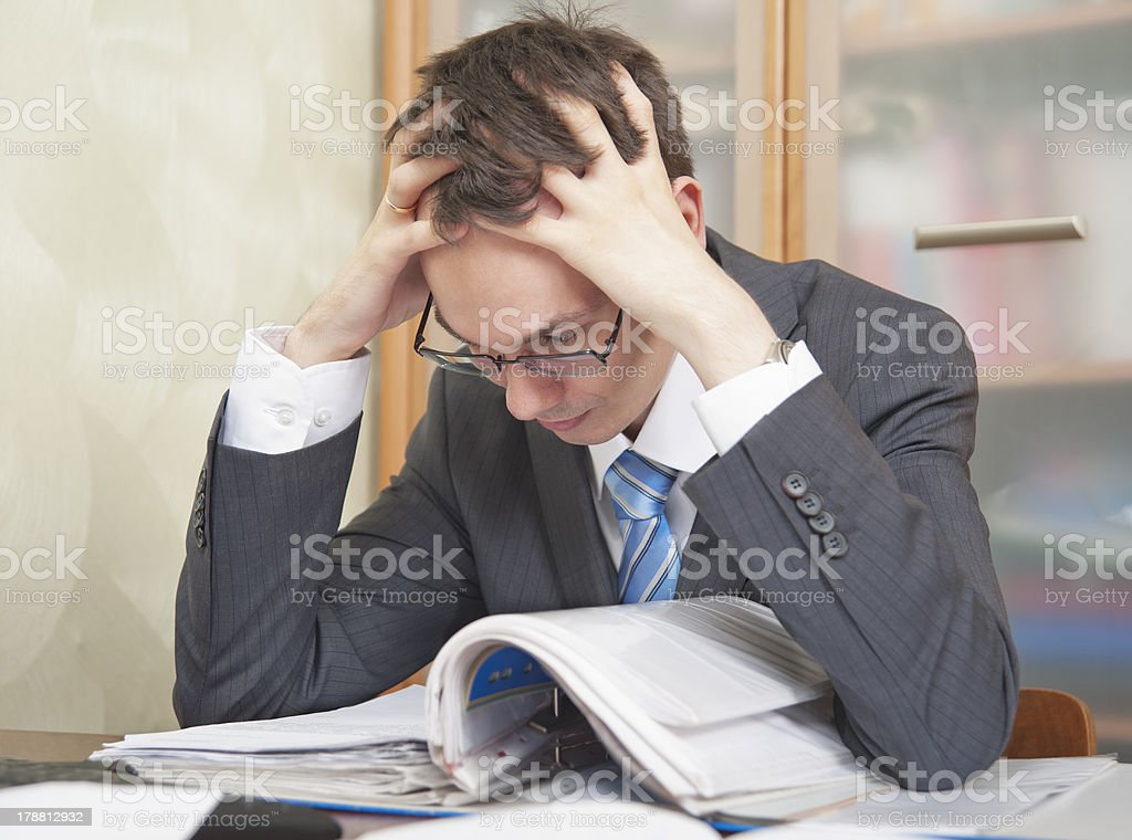 Young man is reading documents stock photo