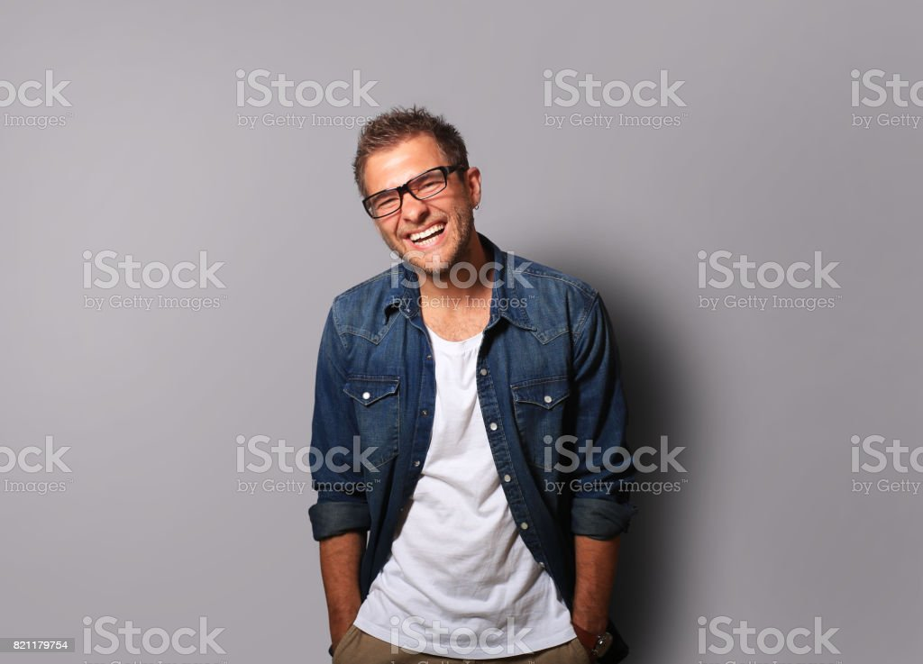 Young man is smiling stock photo