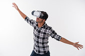 young man is surprised by content on VR glasses
