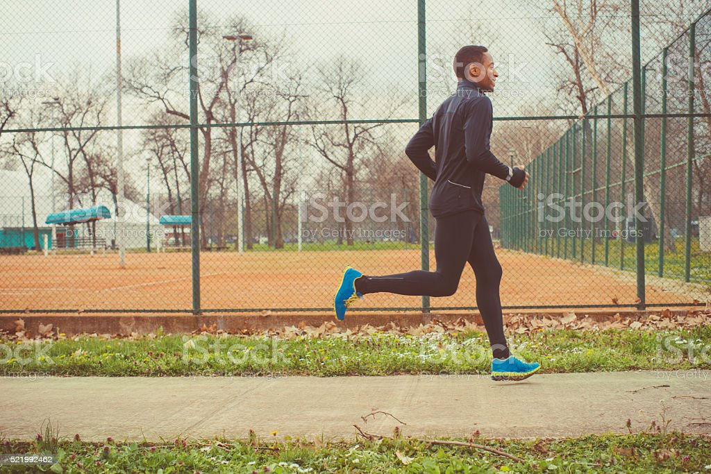 young man jogging outdoor stock photo