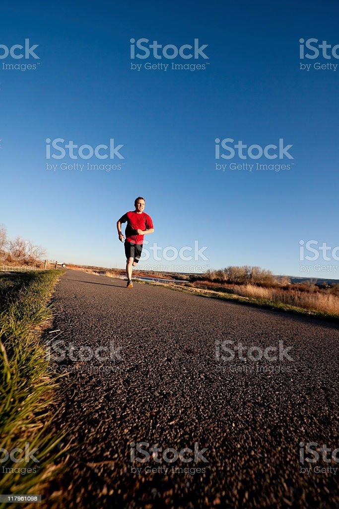 Young Man Jogging stock photo