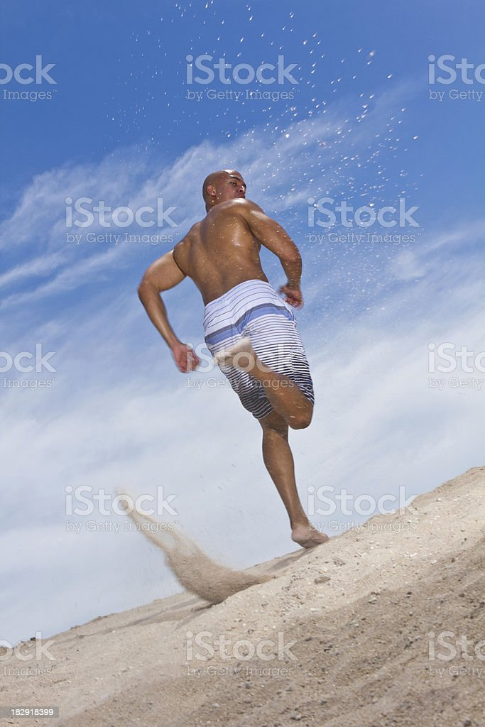 Young man jogging uphill royalty-free stock photo
