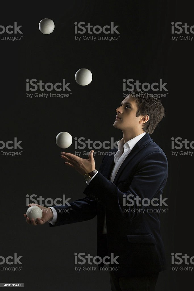 Young man juggling balls stock photo