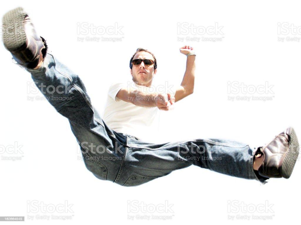 Young man jumping and pointing at the camera royalty-free stock photo