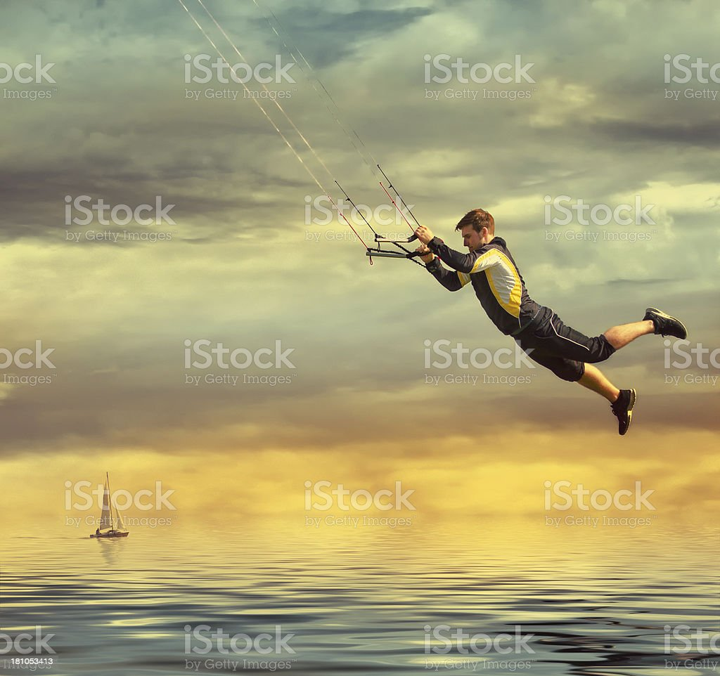 Young man jumping on a kite stock photo