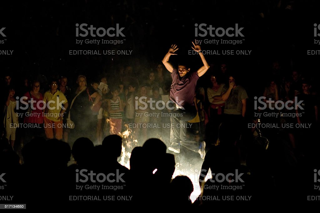 Young man jumping over a Saint John's night bonfire stock photo