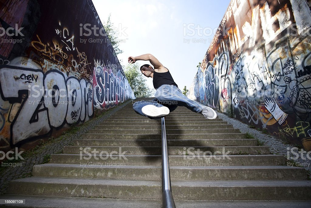 Young man jumping over a wall royalty-free stock photo
