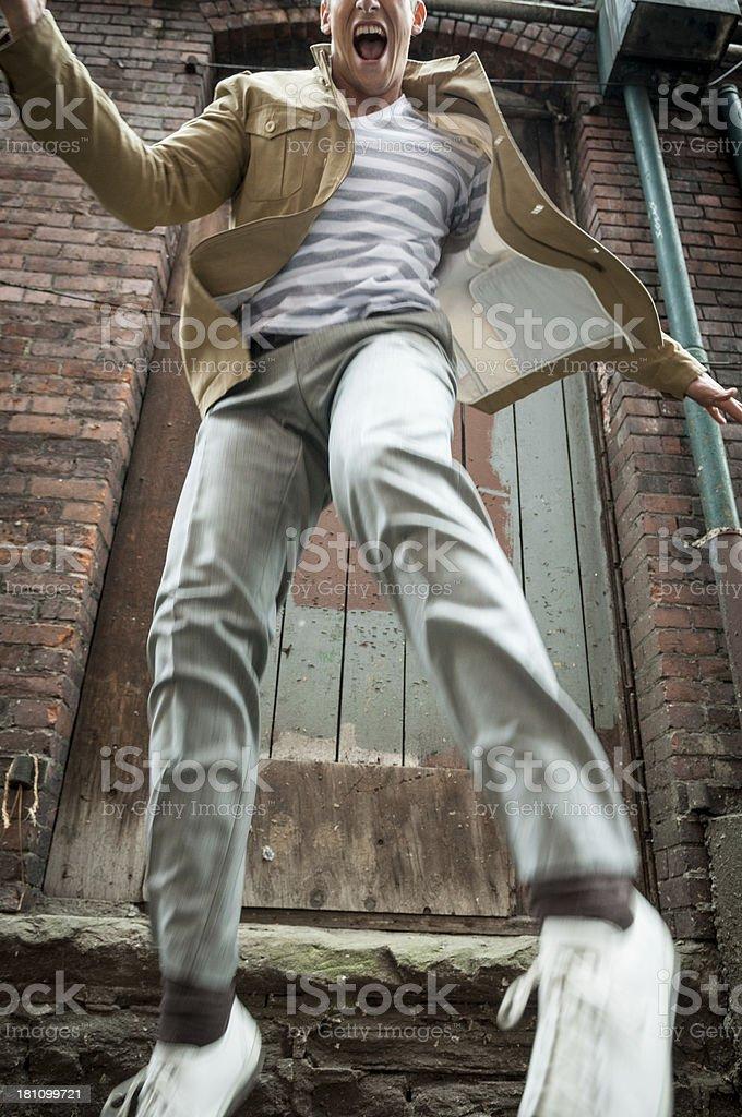 Young man jumping stock photo