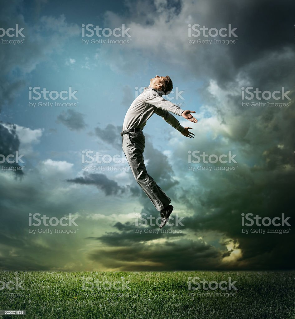 Young man jumping up to Sky stock photo