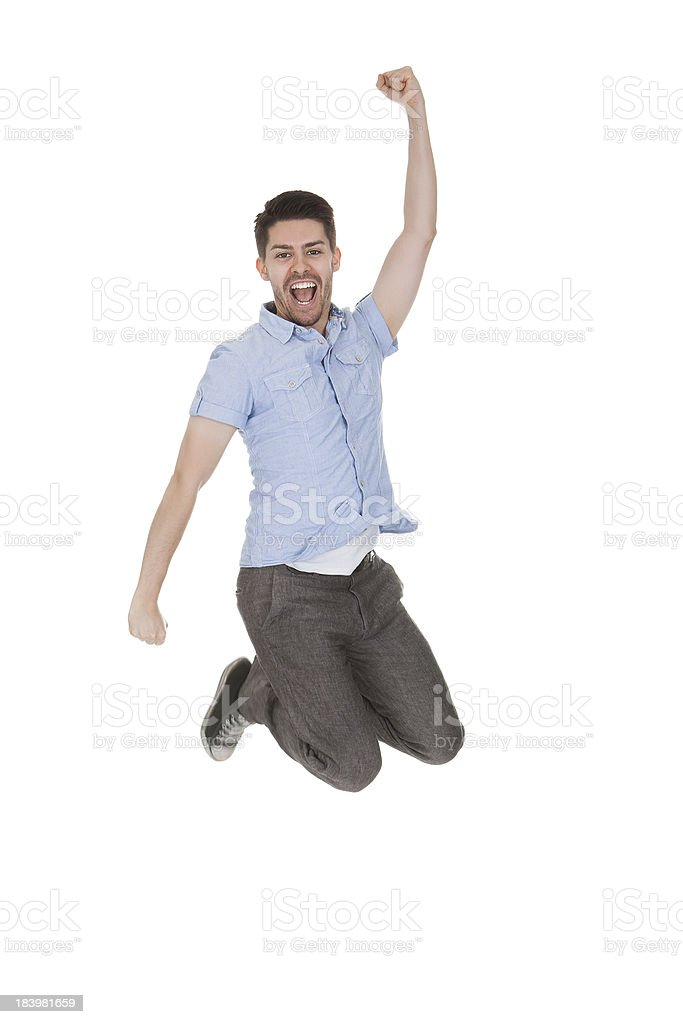 Young Man Jumping With Arms Raised royalty-free stock photo
