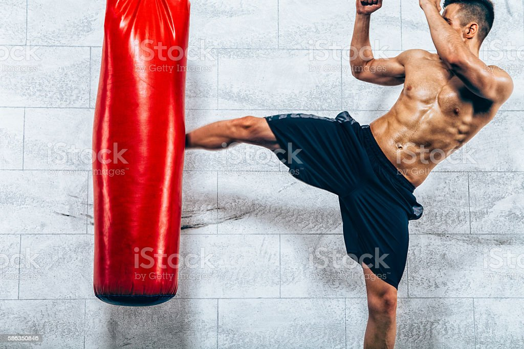 Young man kickboxing workout stock photo