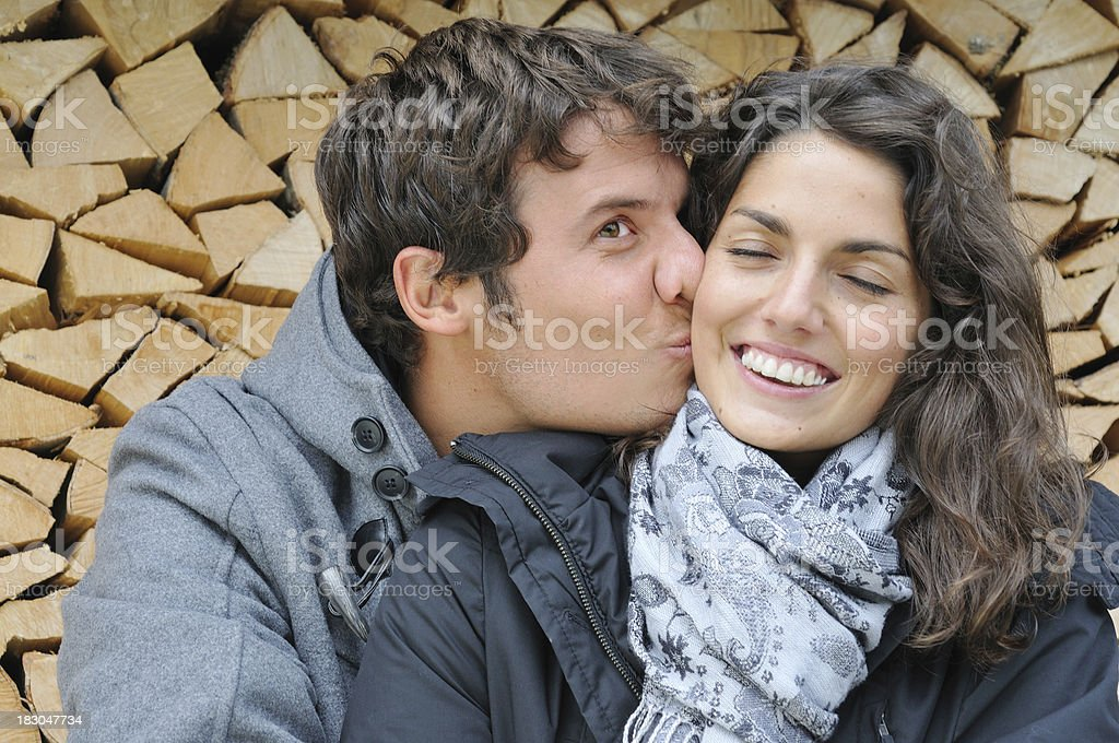 Young man kisses girlfriend royalty-free stock photo