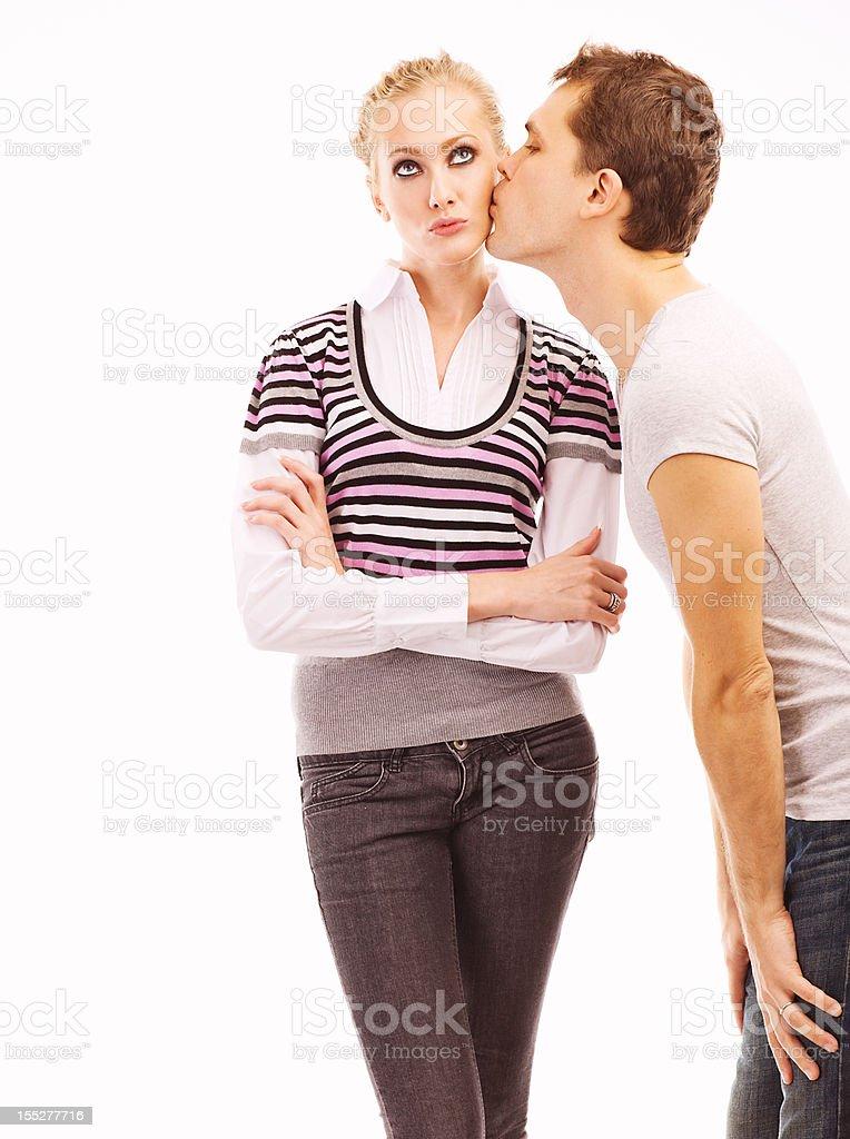 Young man kissing beautiful woman stock photo