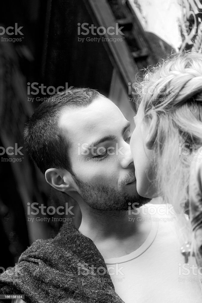 Young Man Kissing his Girlfriend royalty-free stock photo