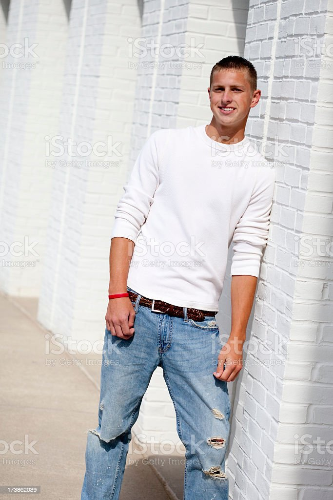 Young man leaning against a wall royalty-free stock photo